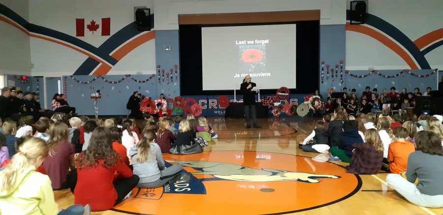 NOTL Town Coun. Norm Arsenault speaks during the Remembrance Day ceremony at Crossroads Public School. (Supplied)