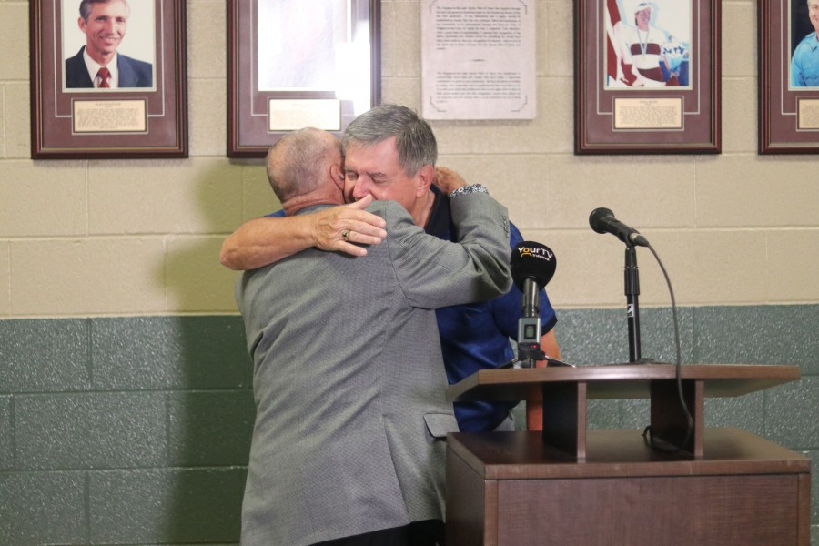 Doug Garrett hugs Ward Simpson, who is a Sports Wall of Fame committee chair. (Dariya Baiguzhiyeva)