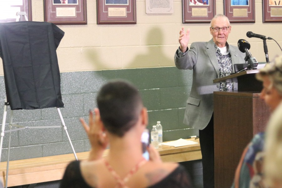 Doug Garrett waves to his granddaughter Dahlia Clarke during his speech. (Dariya Baiguzhiyeva)
