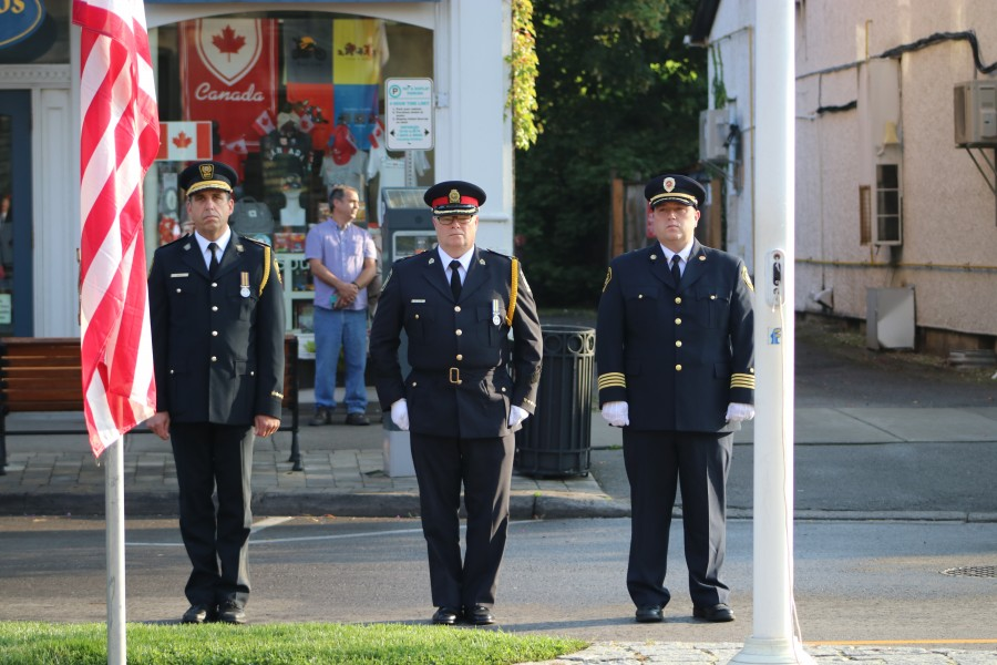 Niagara EMS chief Kevin Smith, Niagara Regional Police deputy chief Brett Flynn and NOTL fire chief Nick Ruller at the memorial service. (Dariya Baiguzhiyeva/Niagara Now)