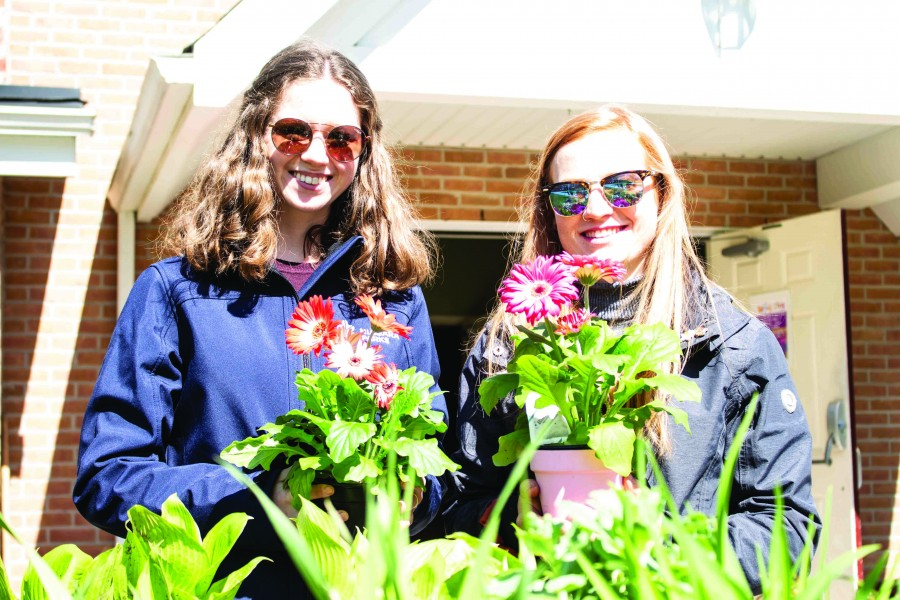 Mattison Innis and Leslie Hockley, first-year Niagara Parks School of Horticulture students, at the St. Mark' spring garden sale Saturday. (Richard Harley/Niagara Now)